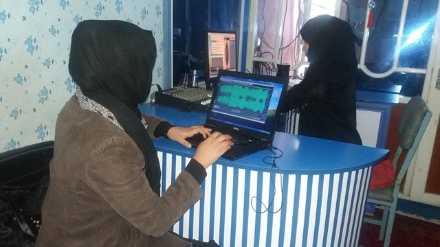 Women journalists work at Radio Roshan