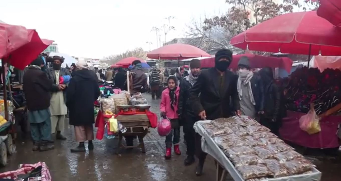 A market in the Kundz provincial capital is filled mainly with men