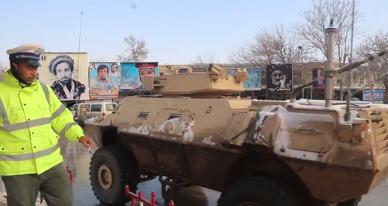 An Afghan army armored vehicle crosses a main square in central Kunduz