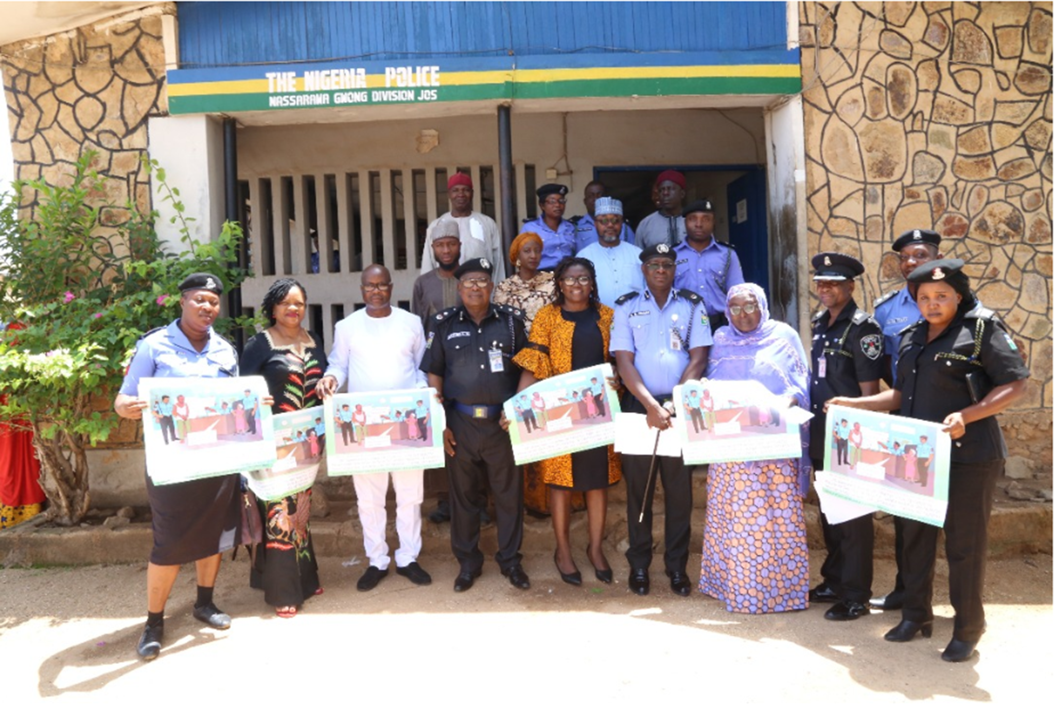 Community leaders and police in Jos, Nigeria, gather in May to inaugurate a unit to combat sexual and gender-based crimes.