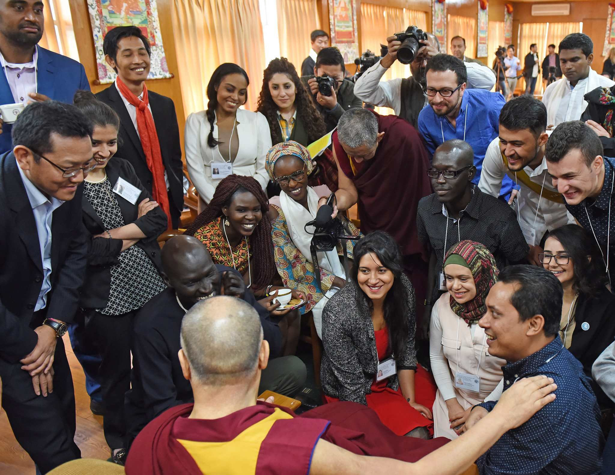 Gatkuoth (center-right in black shirt) says his mentorship by the Dalai Lama and help from USIP have strengthened his work.