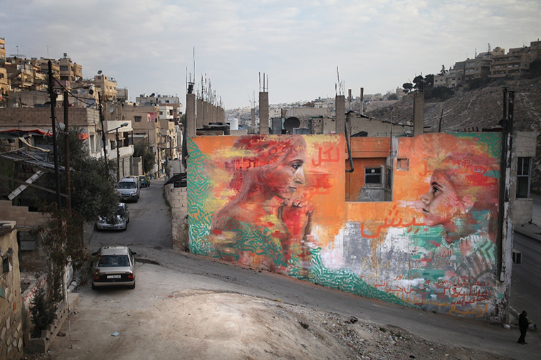 In Amman, Jordan, artist Jonathan Darby discussed with young men and women traditions that hold women back. They painted a mural in which a woman and a girl share their gaze. The image seeks to invoke the passing to new generations of courage to make change. Photo: aptART