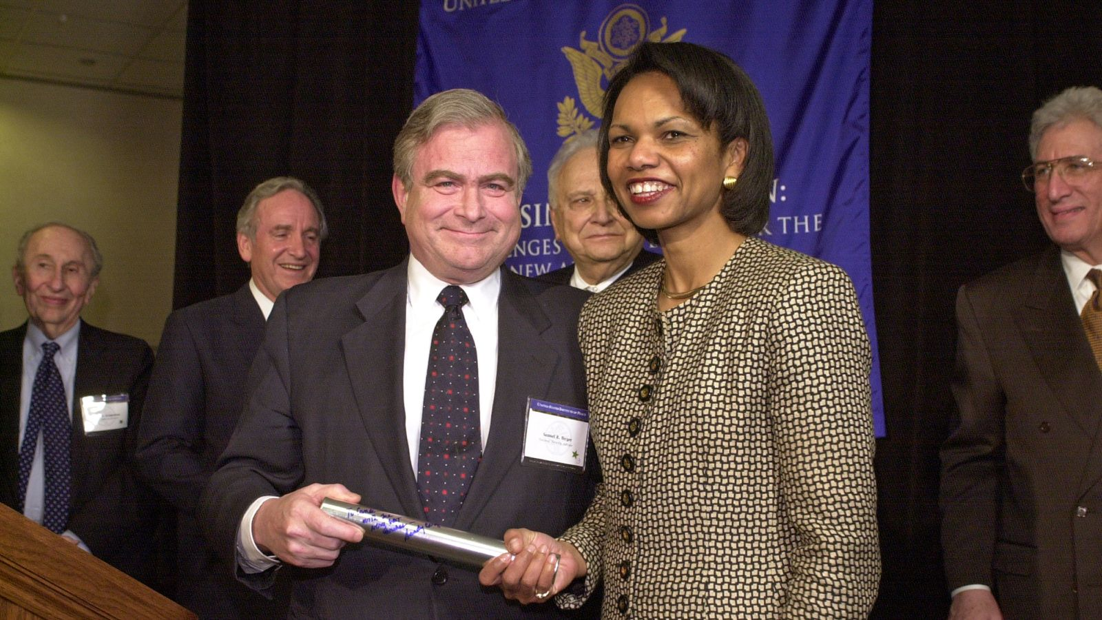 "Samuel Richard ""Sandy"" Berger, United States National Security Advisor for President Bill Clinton passing the baton to then-incumbent Condoleezza ""Condi"" Rice who served United States Secretary of State under of President George W. Bush"