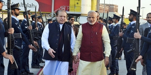 Prime Ministers Narendra Modi of India, right, walks with Prime Minister Nawaz Sharif of Pakistan after arriving at Lahore for a surprise visit to Pakistan, Dec. 25, 2015. The visit, the first by an Indian leader since 2004, was a dramatic gesture to break the ice at a time when relations between the two nations have been almost completely stalled. (Indian Press Information Bureau via The New York Times)