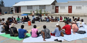 Midday mediation at Sakala, a program for youth located deep in Cite Soleil, Haiti's largest slum. Students come here to play sports, create art projects, and grow a local garden.