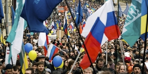 "Demonstrators wave flags and banners during a ""March for Peace"" rally opposing President Vladimir Putin and war in Ukraine, in Moscow, March 15, 2014."