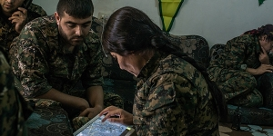 Kurdish Y.P.G. fighters inspect maps and check locations as they coordinate an airstrike with the U.S. against an ISIS position, Hasaka, Syria, July 31, 2015. The Y.P.G. has been one of the few groups to constantly and effectively battle ISIS in Syria. (Mauricio Lima/The New York Times)