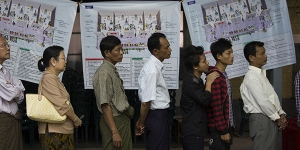 Voters line up at a polling station in Dagon High School in the Dagon township of Yangon, Myanmar, Nov. 8, 2015. The opposition party of the Nobel Peace laureate Aung San Suu Kyi said Monday that it was confident of a sweeping victory in the country's landmark nationwide elections, while the ruling military-backed party acknowledged its poor showing.