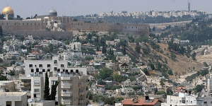 The Dome of the Rock looms over the area of East Jerusalem known as Sliwan, which holds the remains of the city of King David and his dynasty, on June 15, 2005. A proposal to demolish Palestinian homes in the area to make way for a park have sparked controversey.