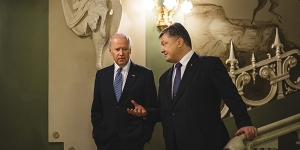 Ukrainian President Petro Poroshenko, right, and Vice President Joe Biden talk during a meeting in Kiev, Ukraine, Dec. 7, 2015. Biden assured Ukrainian leaders that Russian cooperation in Syria would not change America's position, and also pressed them to do more to battle corruption.