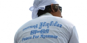 person with shirt that says peace for burma