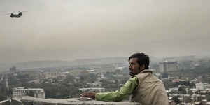 Afghan man watching helicopter