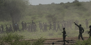 Government soldiers with the Sudanese Peoples Liberation Army march towards the town of Bentiu in South Sudan.