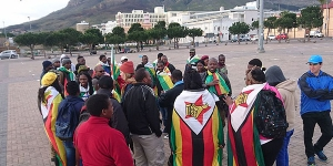 Zimbabweans protesting in Grand Parade, Cape Town, South Africa in support of the This Flag 2016 Zimbabwe protests on Saturday the 16th July 2016.