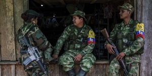 Members of the Revolutionary Armed Forces of Colombia, or FARC, rest in a window of a store in a small village in the mountains of Colombia in March, 2016. Colombia's government and FARC, the largest rebel group in the country, have reached a deal to end more than 50 years of conflict, the two sides announced on Aug. 24, paving the way for an end to the longest running war in the Americas.