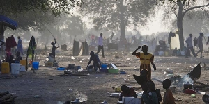 Families fleeing fighting in and around the town of Bor are seeking refuge under the shade of any available tree on the other side of the river Nile from their home.