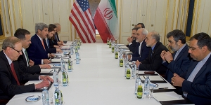 U.S. Secretary of State John Kerry, Iranian Foreign Minister Javad Zarif, and their respective advisers sit across from one another on January 16, 2016, at the Palais Coburg Hotel in Vienna, Austria, before a meeting about the implementation of the Joint Comprehensive Plan of Action outlining the shape of Iran's nuclear program.