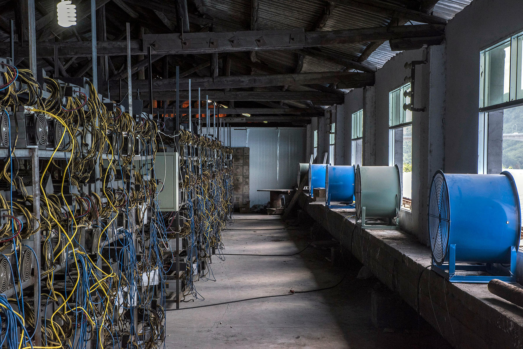 Fans cool racks of bitcoin-mining machines at a server farm.