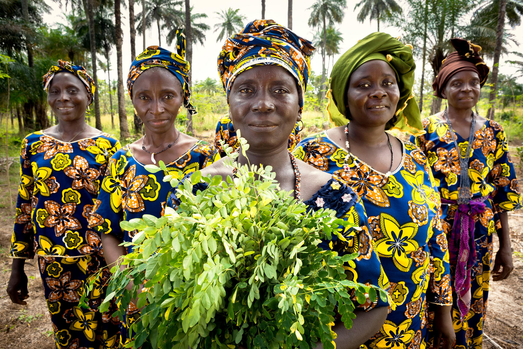 Women from a rural tribe in Guinea face a camera (Photo courtesy of UN Women)