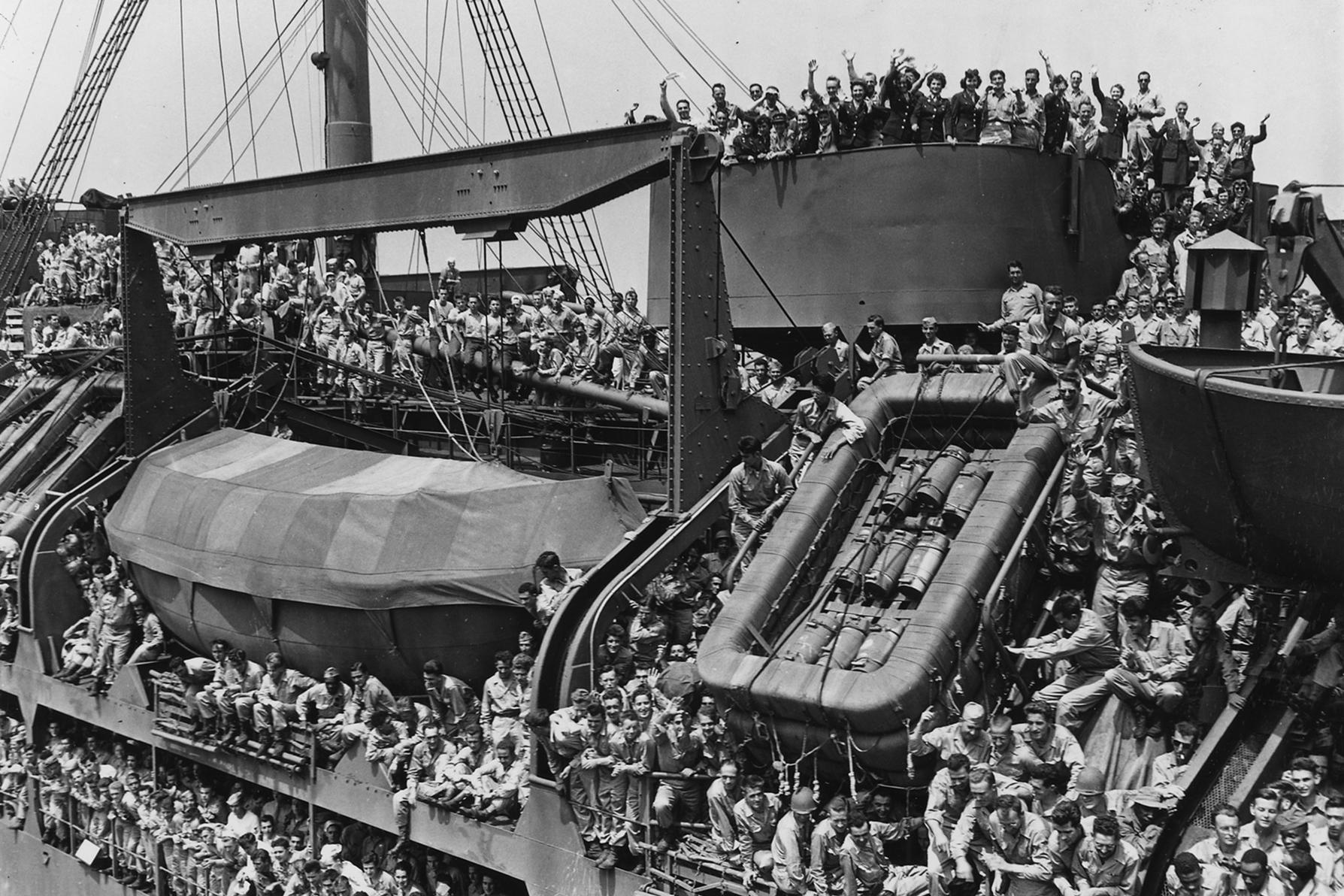 U.S. troops return to New York aboard the USS General Harry Taylor from their service in World War II. Veterans of that war later led in the campaign to establish the U.S. Institute of Peace. (National Archives)