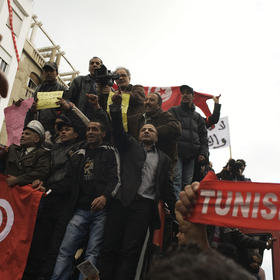 Officers of Tunis' central artery, Avenue Bourguiba, organize a protest in Tunis, Tunisia, Jan. 22, 2011. (Moises Saman/The New York Times)