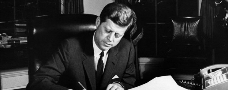 President Kennedy signs the Proclamation for Interdiction of the Delivery of Offensive Weapons to Cuba at the Oval Office on October 23, 1962