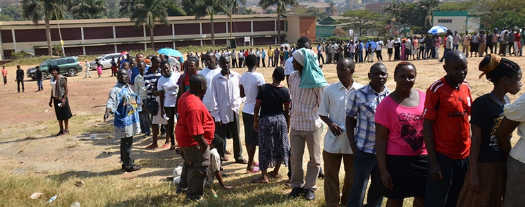Commonwealth observers at polling stations, as Ugandan people cast their votes.