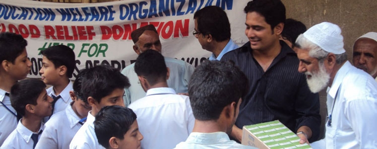 Nadeem Ghazi with students providing relief supplies to flood victims in Pakistan.