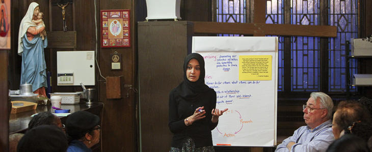 Faiza Ali, a Muslim trained by a Jewish agency to work with a coalition of mostly Christian churches, speaks during a meeting at Our Lady of Refuge Catholic Church in New York, May 1, 2012. Ali is a community organizer trying to increase the impact of the religious left in policy debates.