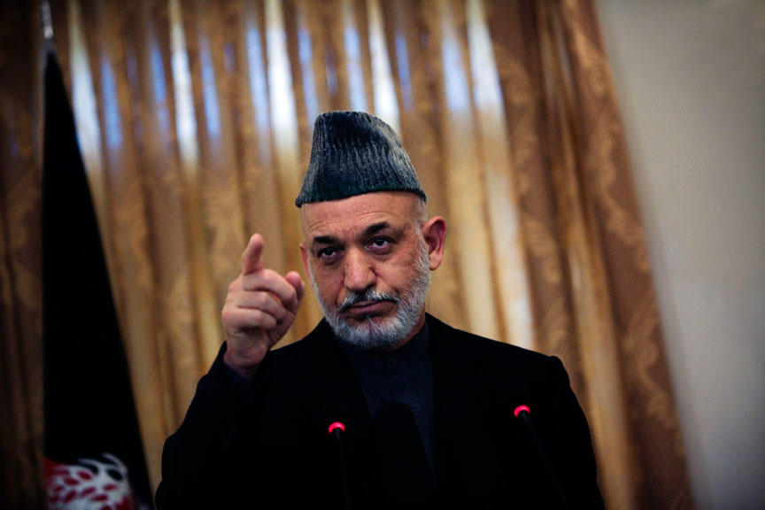 Afghan president Hamid Karzai gestures during a press conference in Kabul, Nov. 23, 2010.
