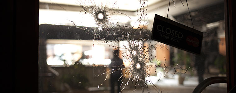 A store window riddled with bullet holes caused during a four-day siege at Westgate Mall in Nairobi, Kenya, Sept. 30, 2013. The attack, which the Islamist extremist group al-Shabab has taken credit for, left more than 60 people dead and scores more wounded. (Tyler Hicks/The New York Times)