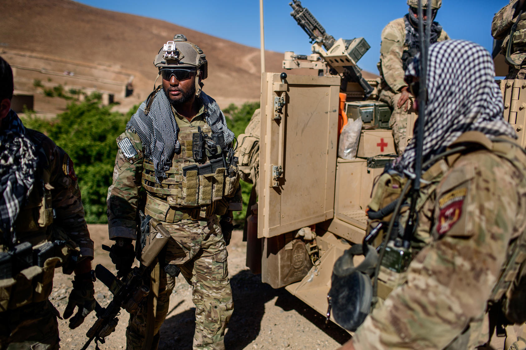 American and Afghan Special Forces soldiers during a patrol in Afghanistan's Parwan province, June 26, 2014. President Obama will announce on Thursday, Oct. 15, 2015 that the U.S. will halt its military withdrawal from Afghanistan and instead keep thousands of troops in the country through the end of his term in 2017.
