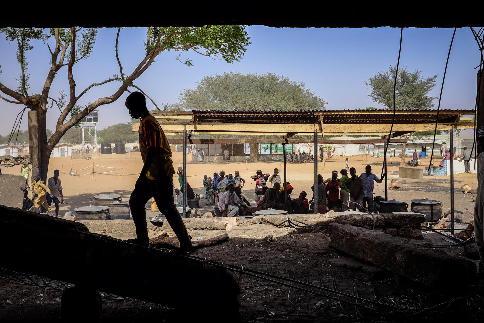 Children at the Dalori government camp set up for civilians who have fled the Boko Haram militant group, on the outskirts of Maiduguri, Nigeria, April 20, 2016. Many Nigerians who have returned from captivity after being kidnapped and raped by Boko Haram are met with suspicion that they have joined the militants' ranks. (Ashley Gilbertson/The New York Times)