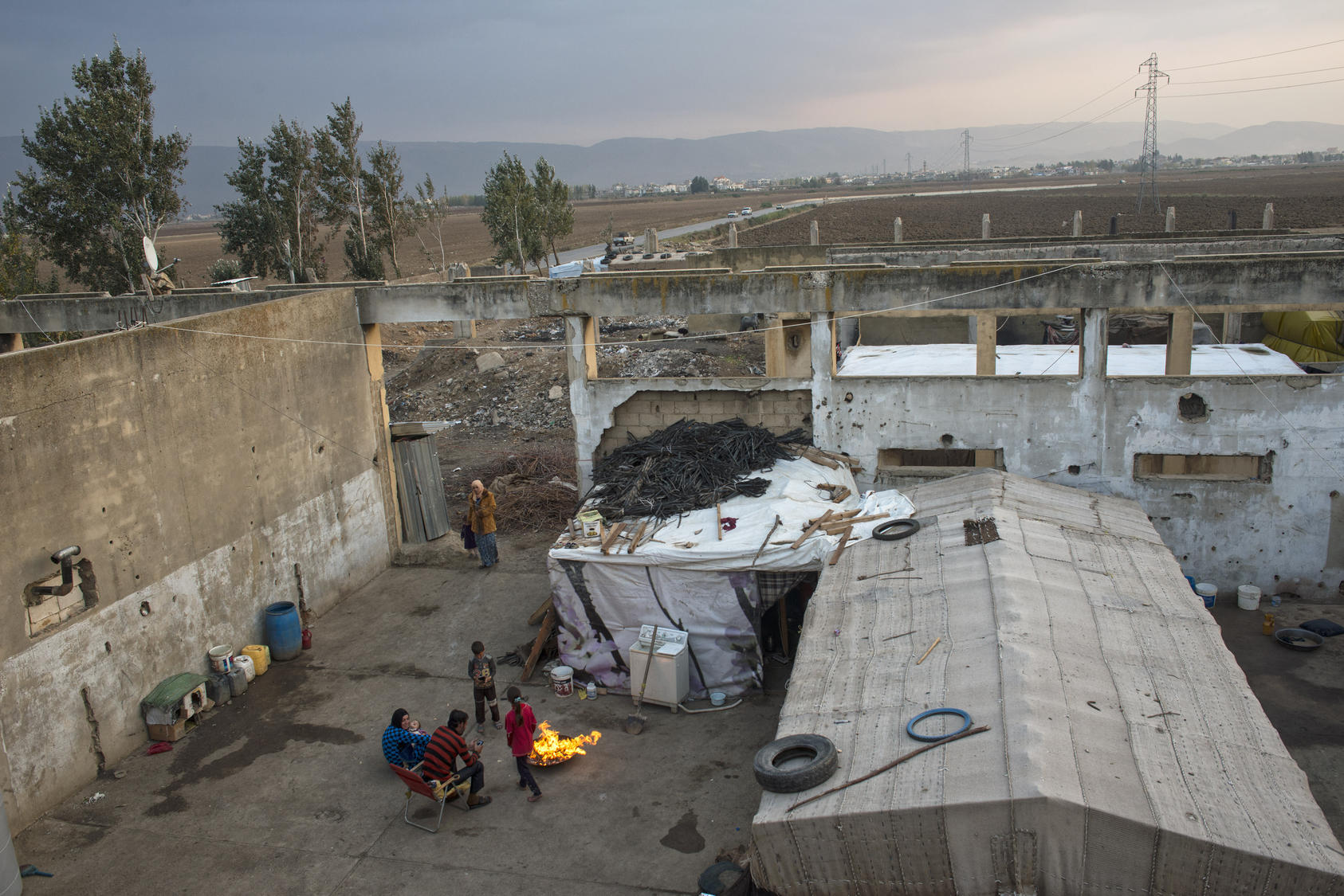 Syrian refugees live in a factory bombed by the Israeli military in 1982 near Faida, Lebanon. Photo Courtesy of The New York Times/ Lynsey Addario