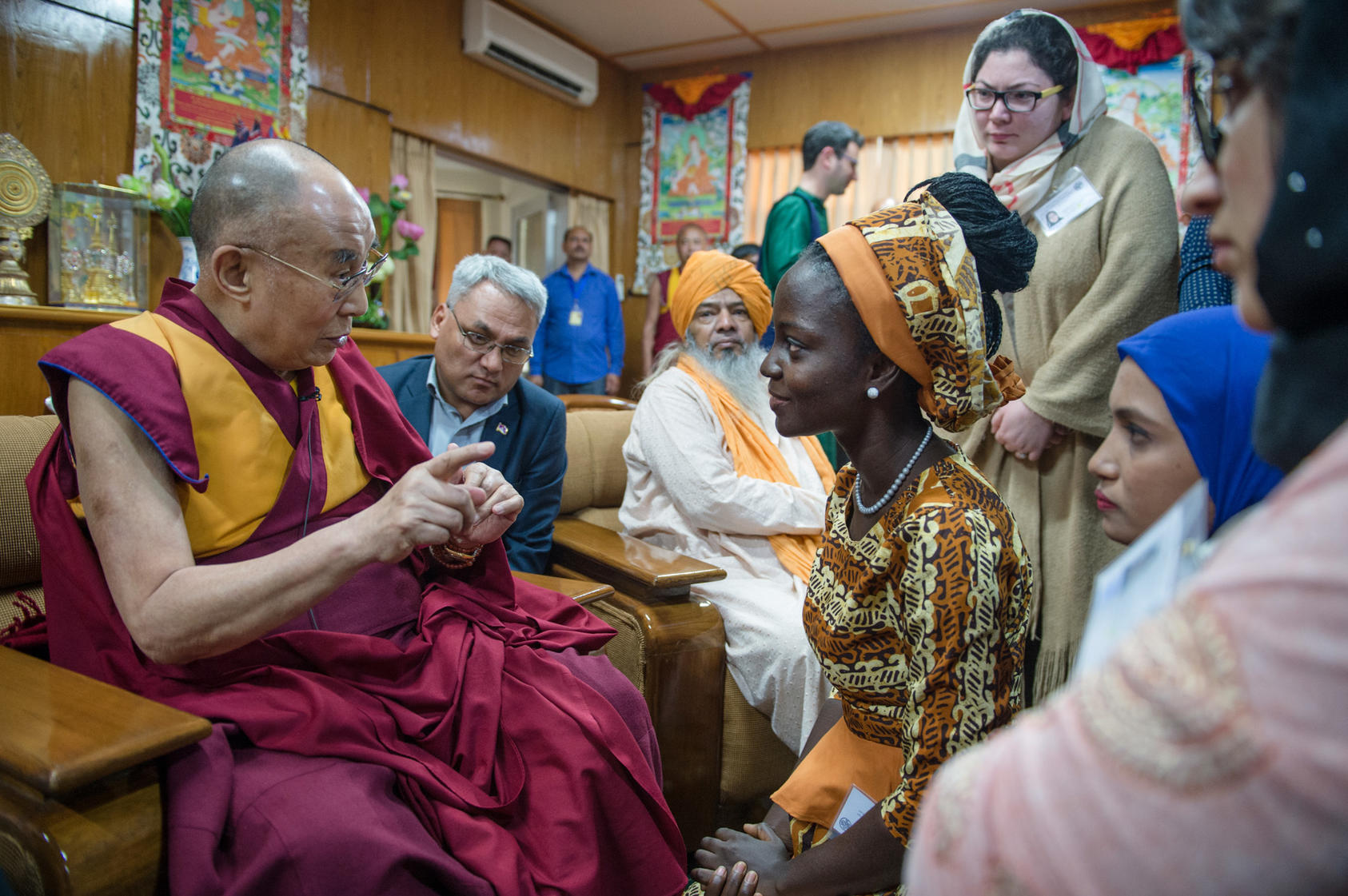 His Holiness the Dalai Lama serves cookies to young peace leaders during meetings with them at his residence in Dharamsala, India. Photo: Tenzin Choejor/OHHDL