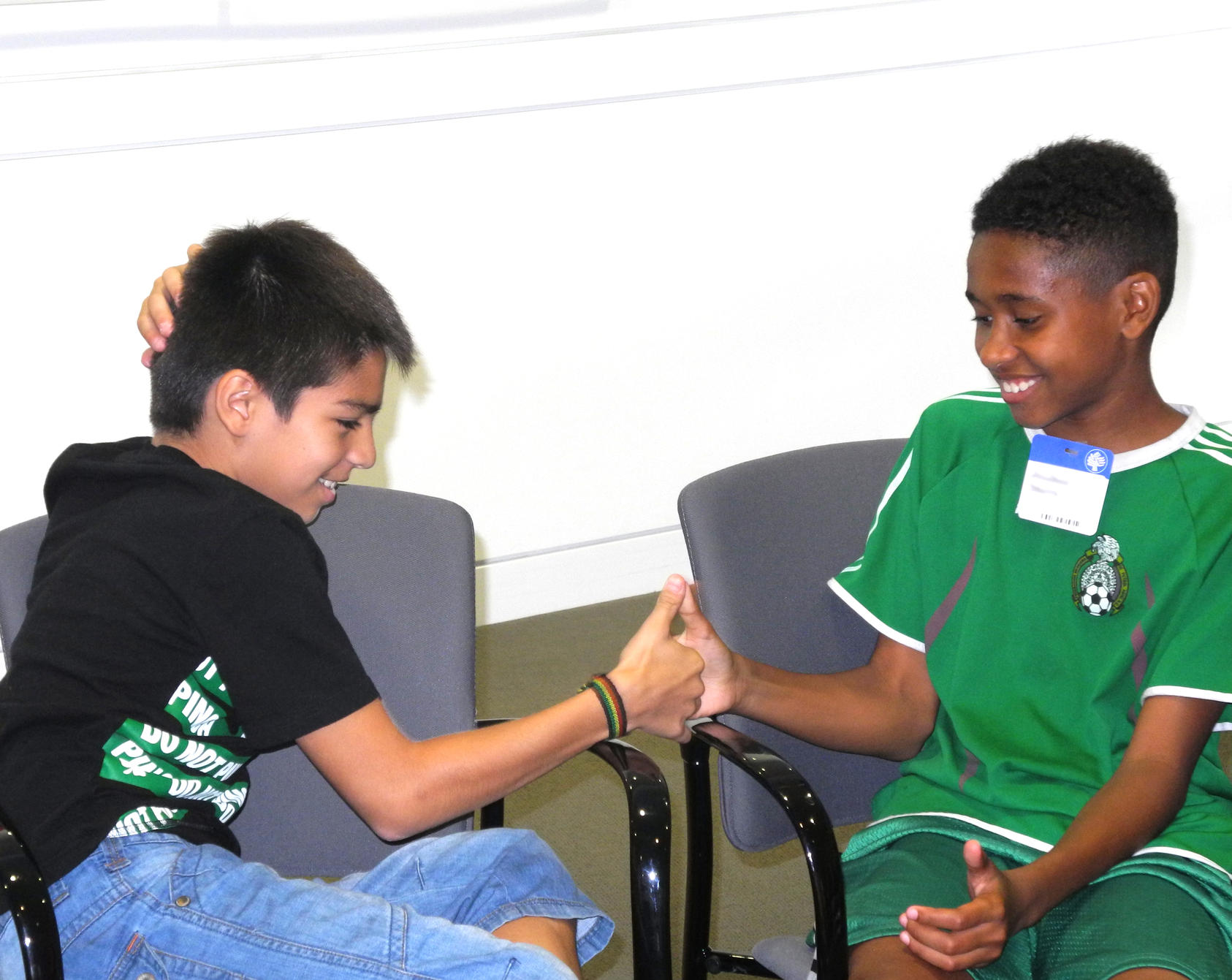 Students participating in the Thumb Wrestling: Competition Versus Cooperation activity at USIP.