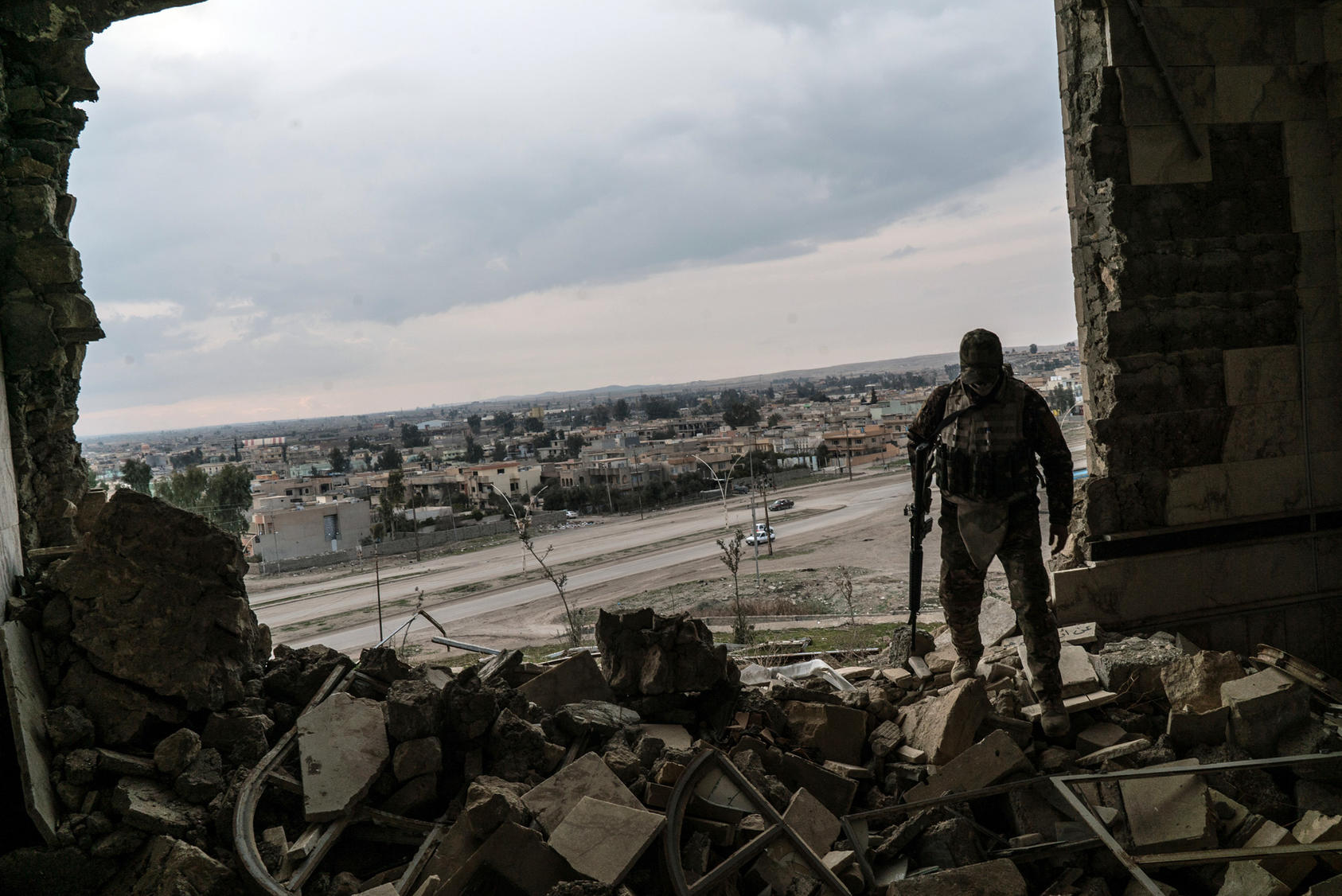 An Iraq soldier in a damaged building in Mosul in February, 2017. The overall push to free Mosul, once Iraq's second-largest city, began in October, with local troops pushing from the east into the city's geographically larger but more sparsely populated eastern half. In late January, they reached the banks of the Tigris River, which bisects Mosul, and declared the city's eastern section liberated. (Ben C. Solomon/The New York Times)