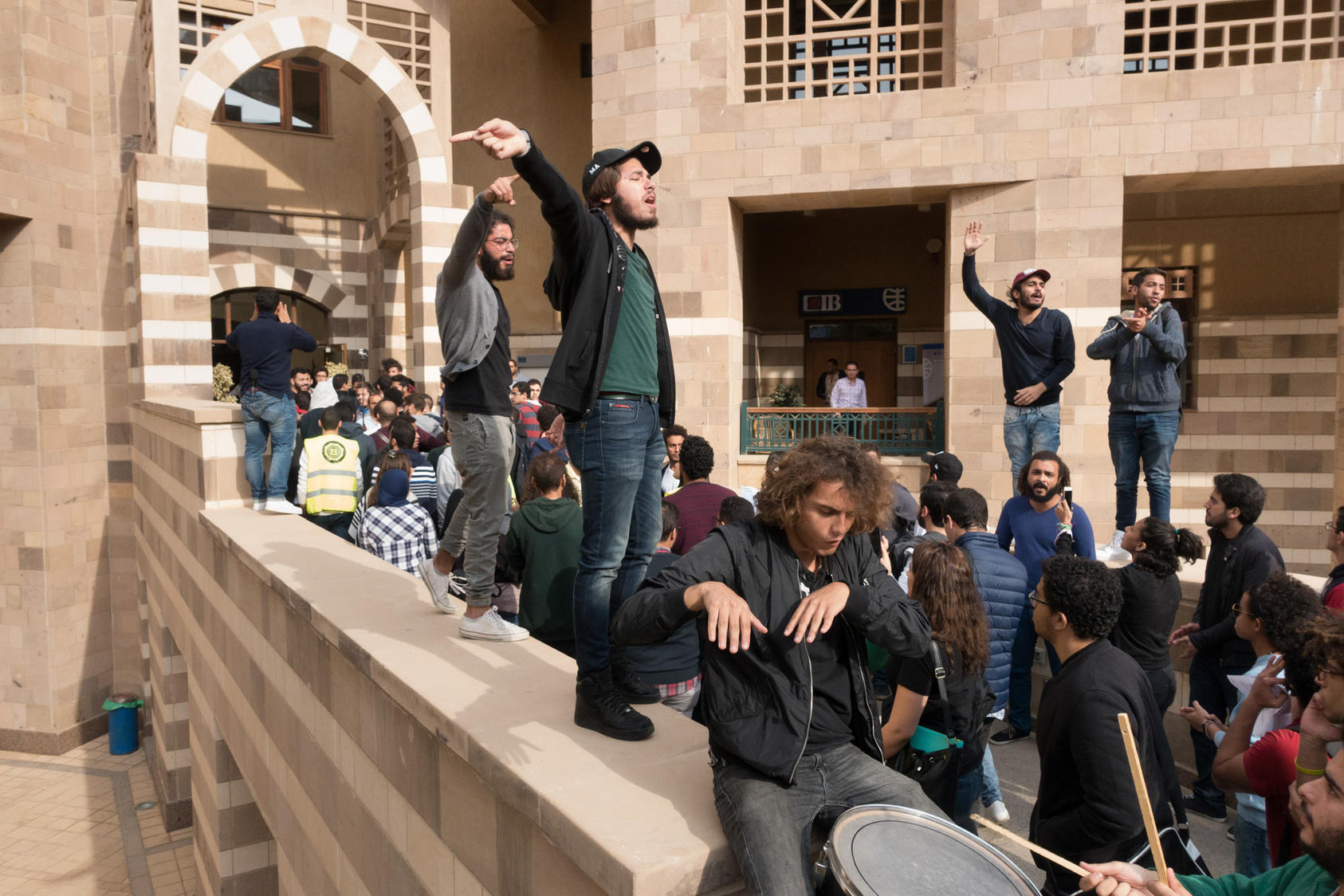 "Students protest at the American University of Cairo, demanding a cap to their tuition, in Cairo, Nov. 16, 2016. The demonstrations are the largest and longest-running at the elite institution in years. ""When the economic crisis hits the elite, it means the suffering is all over the place,"" said Malak Rostom, vice president of the student union. (David Degner/The New York Times)"