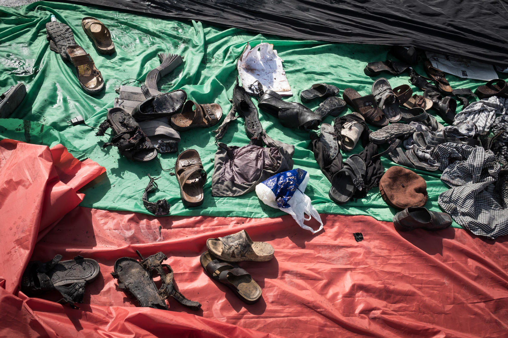 Scattered belongings after a suicide bombing targeting a demonstration by Hazaras, an ethnic minority group, in Kabul, Afghanistan