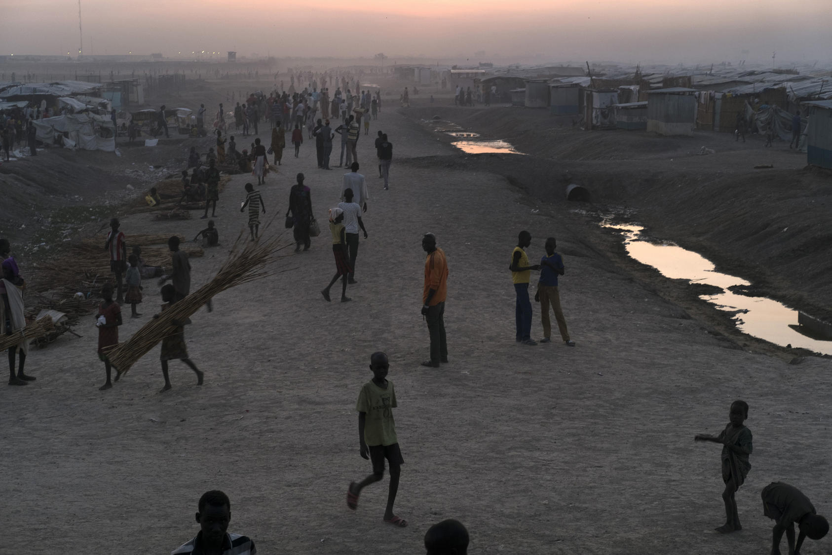 Displaced residents at a camp of makeshift tents and structures of sheet metal and plastic in Bentiu, South Sudan.