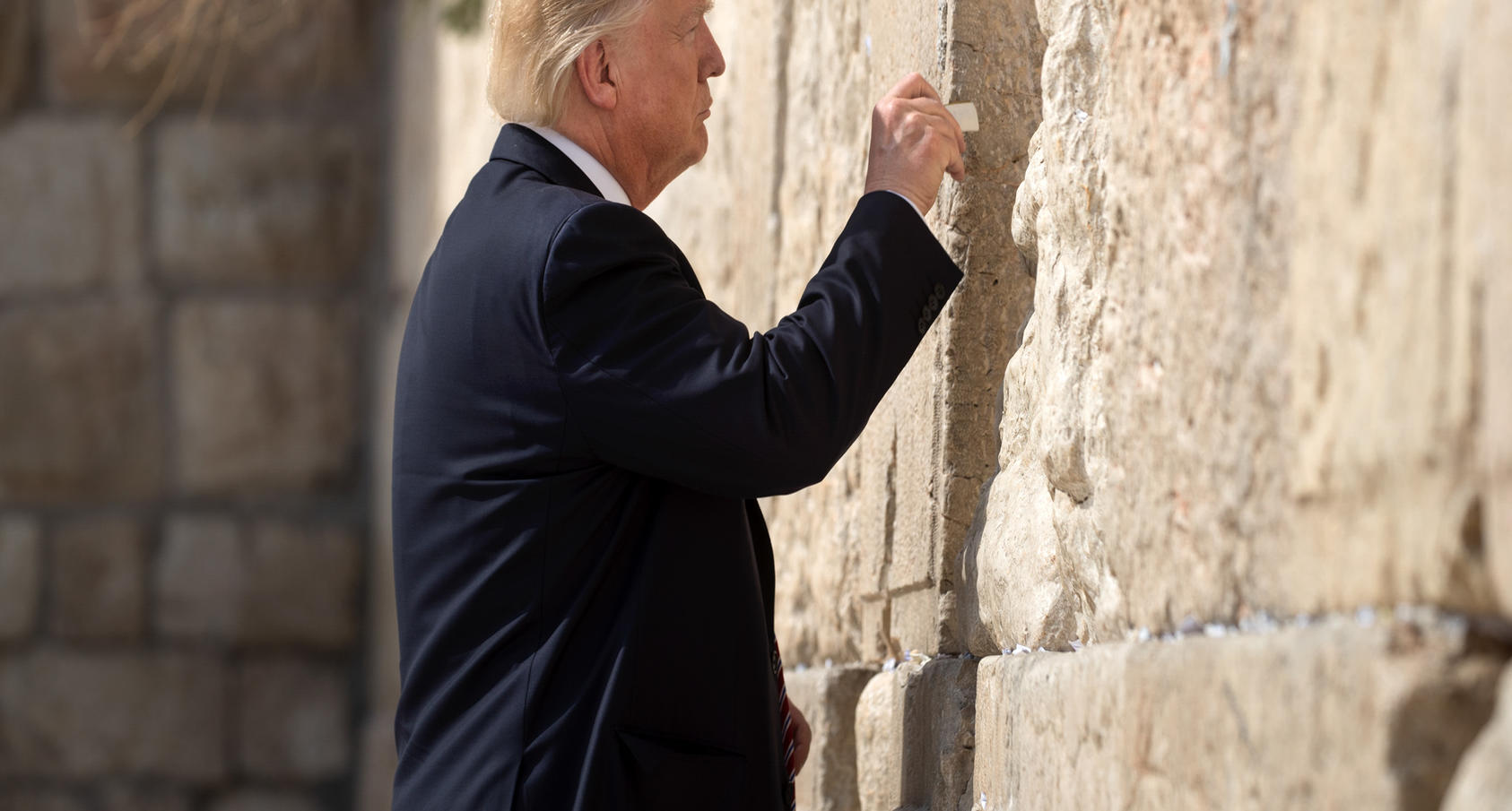President Donald Trump places a paper into the Western Wall in Jerusalem, May 22, 2017. Photo Courtesy of The New York Times/Stephen Crowley