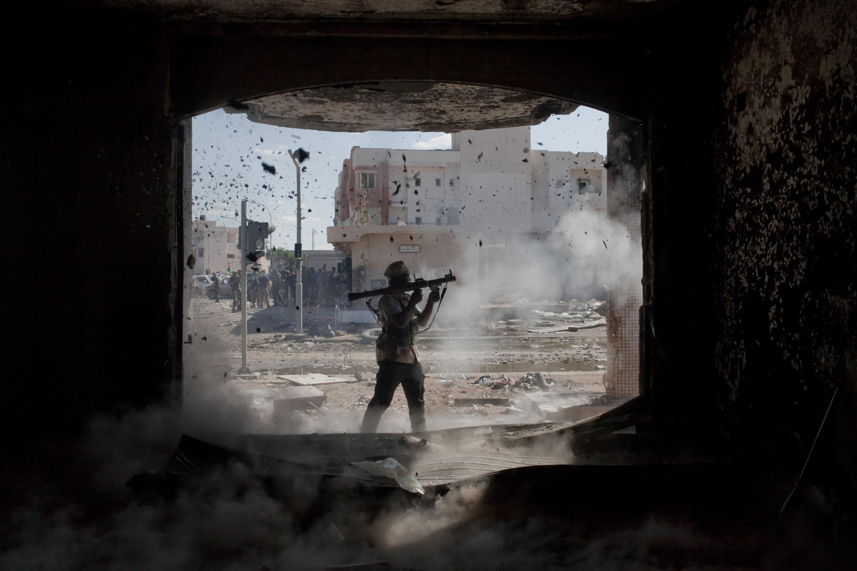 An anti-Gadhafi fighter fires a rocket-propelled grenade during fighting in Sirte, Libya.