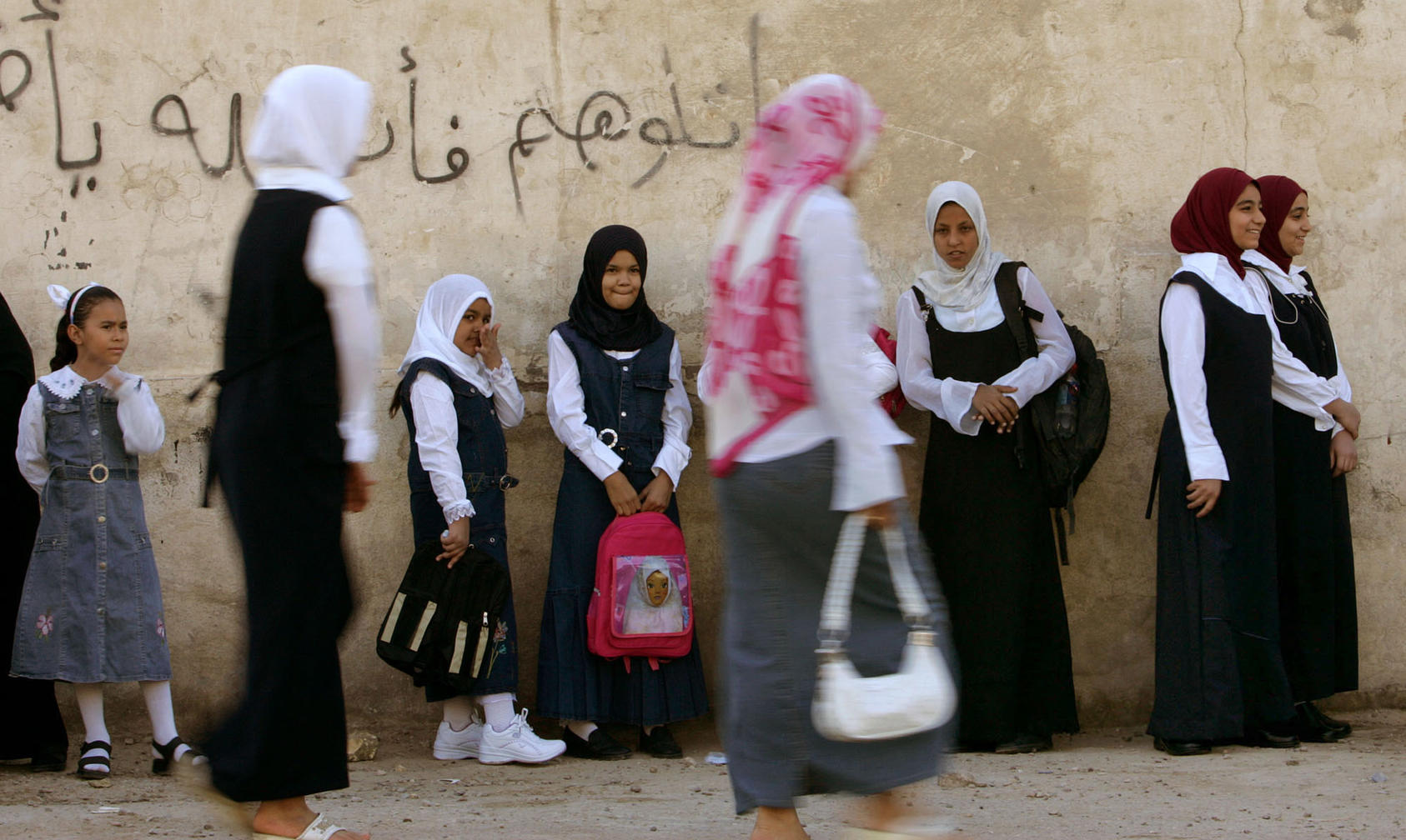Girls wait to head to their classrooms at a school in Sadr City, the predominantly Shiite neighborhood of Baghdad, Wednesday, Sept. 20, 2006. Six million students nationwide returned to school on Wednesday morning after three months of summer vacations, according to Iraqi ministry of education.