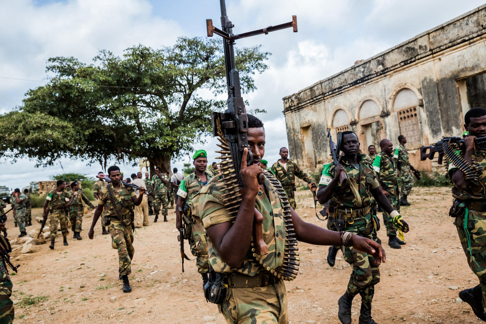 Ethiopian soldiers, part of the African Union peacekeeping mission in Somalia, escort a convoy of trucks carrying food aid in Baidoa, Somalia, June 10, 2014. In a recent attack in Somalia in early 2016, al-Shabab militants massacred as many as 100 Kenyan soldiers in a peacekeeping mission, seizing their equipment. The attack could mark a turning point for the Shabab, one of Africa's most violent militant groups. (Daniel Berehulak/The New York Times)