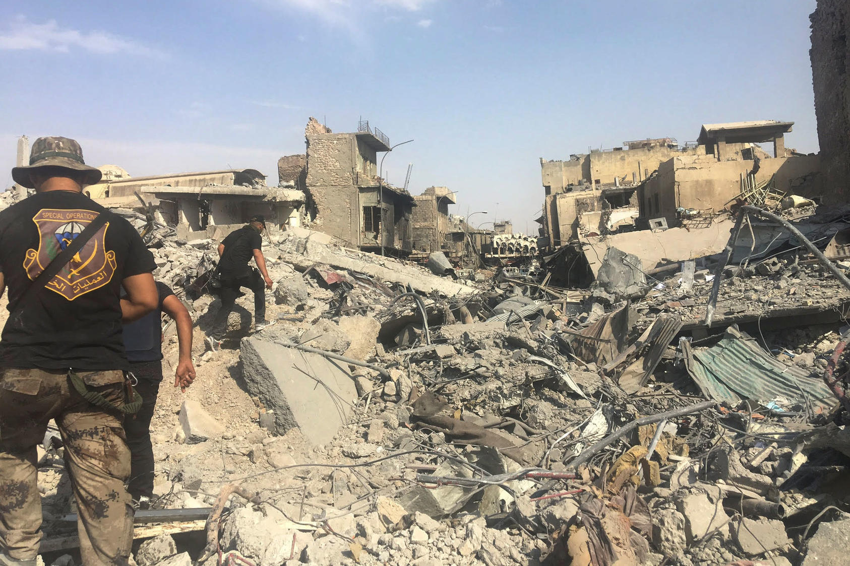 Soldiers pick their way through the ruins of Mosul, Iraq, July 11, 2017. Though Iraq officially declared victory over the Islamic State in Mosul on Sunday, a day later artillery fire could be heard in pockets of the city.