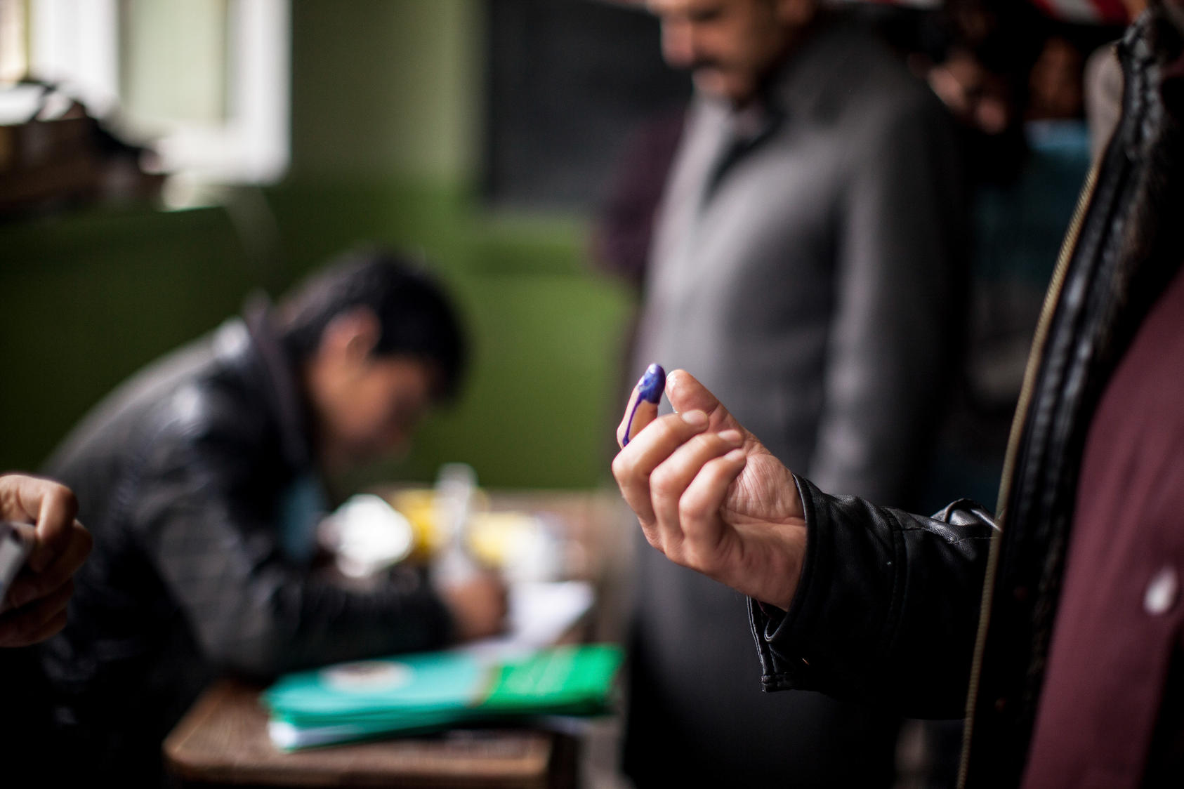 Purple ink was used to mark the fingers of voters in the general election, at a school in Kabul, Afghanistan, April 5, 2014.
