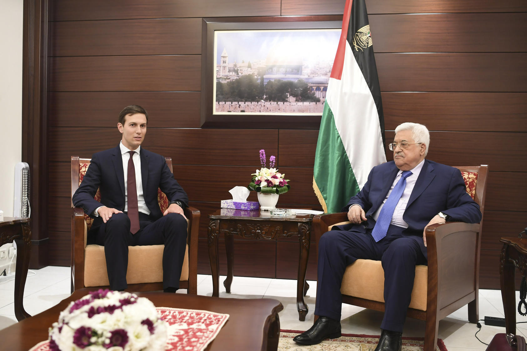 In a handout photo, Jared Kushner, left, President Donald Trump's senior adviser, meets with President Mahmoud Abbas of the Palestinian Authority in Ramallah, West Bank, Aug. 24, 2017.