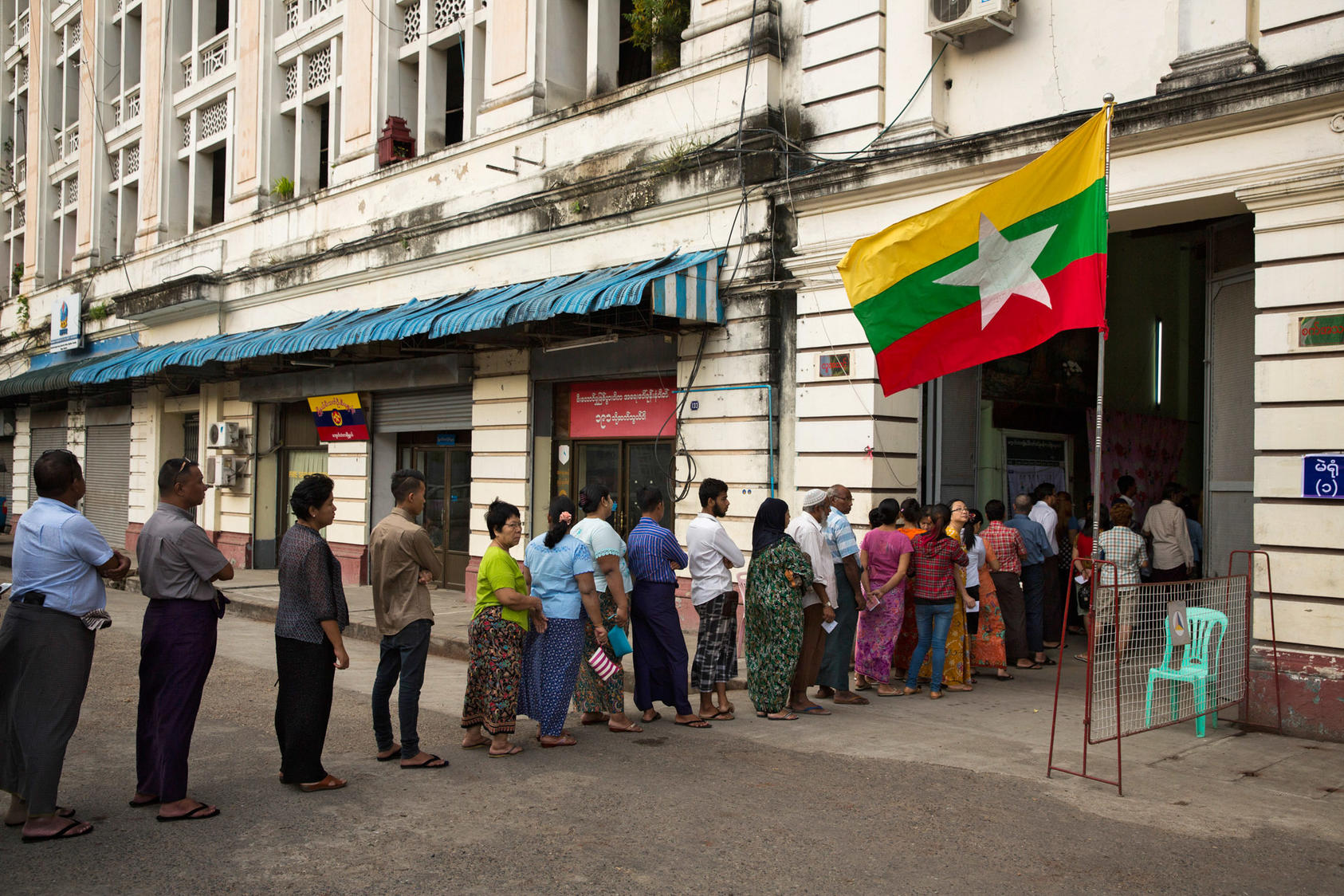 Voters line up outside a polling station in Yangon, Myanmar, Nov. 8, 2015. After five decades of military rule and a series of rigged or canceled elections, voters took part in what many described as their first genuine election. (Adam Dean/The New York Times)