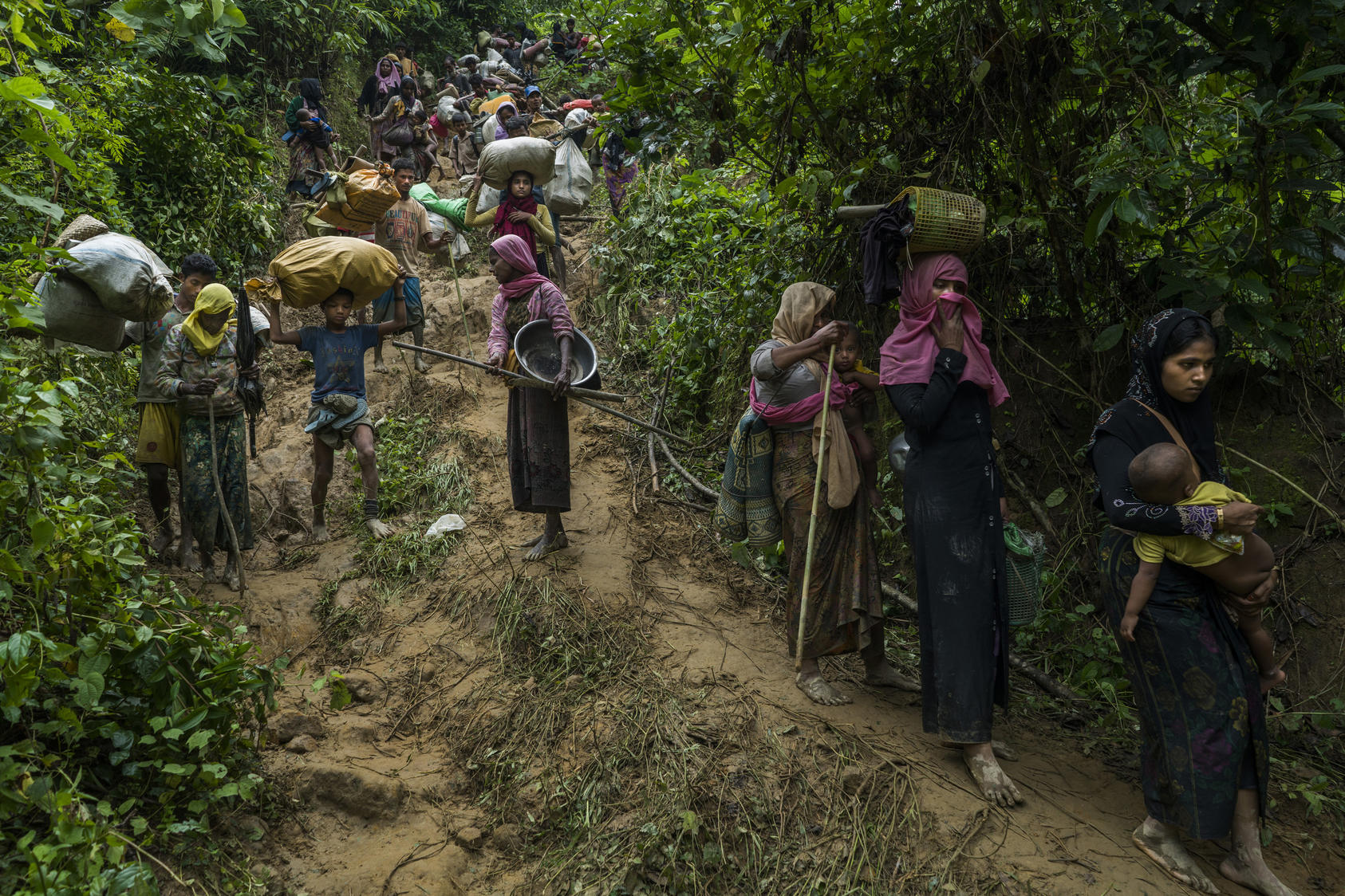 Rohingya refugees from Myanmar after crossing the border illegally near Amtoli, Bangladesh, Sept. 1, 2017. Photo Courtesy of The New York Times/Adam Dean