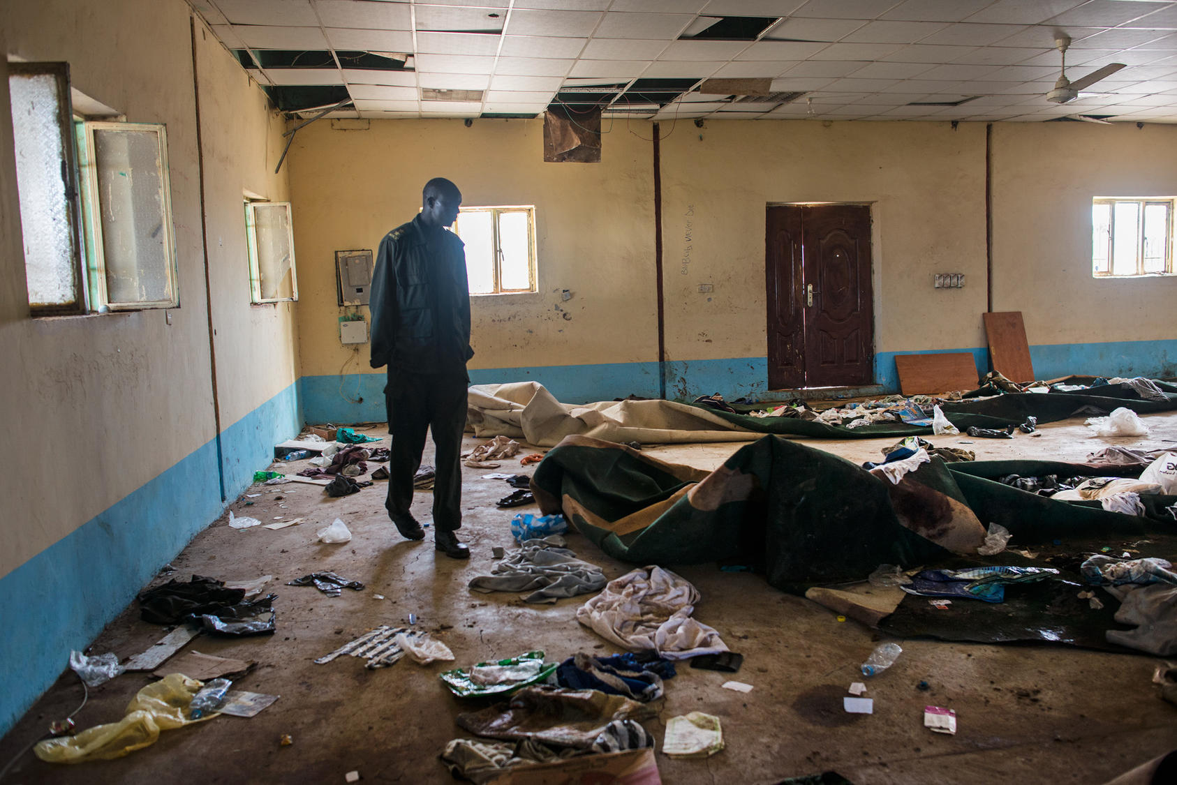 An opposition soldier walks through the remnants of a mosque in Bentiu, South South Sudan, where hundreds of people were killed while taking refuge from the fighting, May 3, 2014. Photo Courtesy of The New York Times/Lynsey Addario